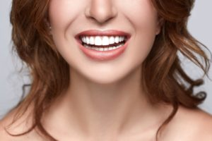 lower half of woman smiling
