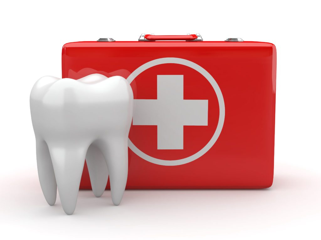 Tooth standing in front of red emergency kit