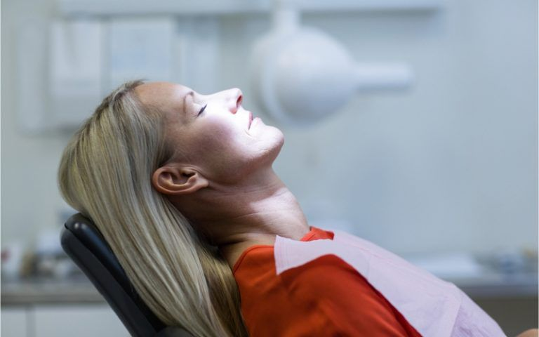 woman relaxing in dental chair